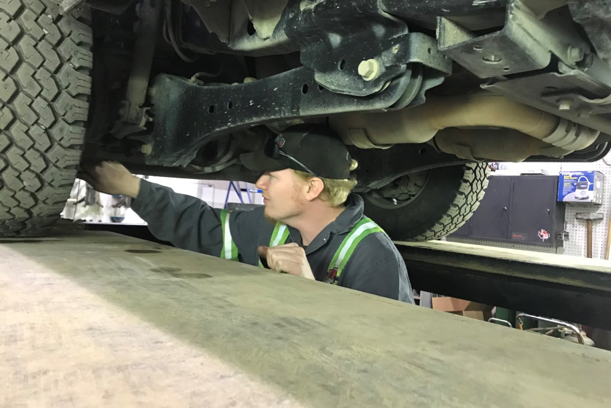 mechanic checking the transmission